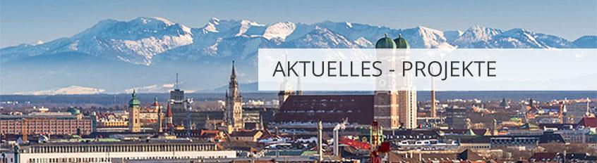 """Blick über die Stadt München, im Hintergrund die Alpen, Banner mit Aufschrift """"Aktuelles-Projekte"""" am rechten Rand"""
